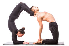 Young healthy couple in yoga position on white background Royalty Free Stock Photos