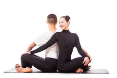 Young healthy couple in yoga position on white background Stock Photo