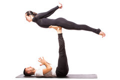 Young healthy couple in yoga position on white background Stock Photos