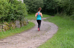 Young healthy fit woman jogging outdoors royalty free stock photos