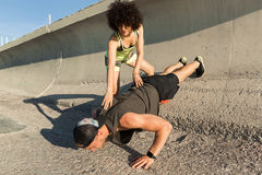Young healthy fitness couple doing sport exercises stock images
