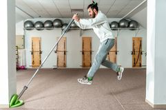Young healthy fitness man jump with barbell weight bar as exercise for endurance and stamina.  stock image