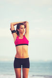Young Healthy Fitness Woman with Smart Phone Royalty Free Stock Images
