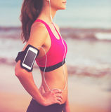 Young Healthy Fitness Woman with Smart Phone royalty free stock photos