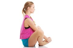 Young healthy girl doing stretching exercises Stock Images