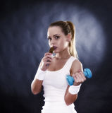 young healthy girl eating a cereal bar Stock Image