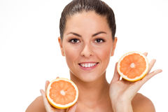 Young healthy girl holding an orange in his hand Royalty Free Stock Images