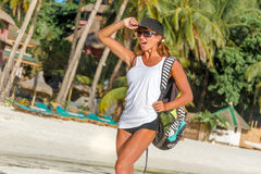 Young healthy girl in sport clothes walking by tropical Royalty Free Stock Photography