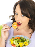 Young Healthy Happy Woman Eating a Freshly Mixed Salad Stock Images