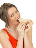 Young Healthy Happy Woman Eating a Salmon and Cucumber Brown Bread Sandwich Stock Image