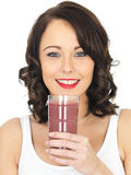 Young Healthy Happy Woman Holding Drinking a Glass of Fresh Mixed Berries Smoothie Royalty Free Stock Photography