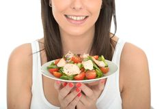 Young Healthy Happy Woman Holding a Plate of Fresh Chicken Salad Stock Photography