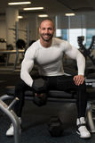 Young Healthy Man Doing Exercise For Biceps Stock Photography