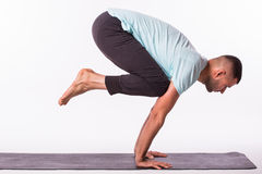 Young healthy Man is making yoga over white background Royalty Free Stock Image