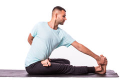Young healthy Man is making yoga over white background Royalty Free Stock Photo