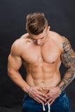 Young and healthy man topless show six pack abs. Handsome male bodybuilder, fitness model Royalty Free Stock Image