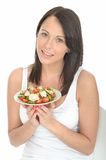Young Healthy Natural Happy Woman Holding a Plate of Cold Cooked Chicken Salad Stock Image