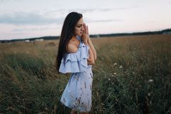 Young woman on sunrise field stock photo