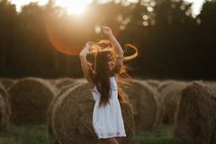 Young woman on sunrise field. Young healthy sensual woman on the sunrise field Stock Photography