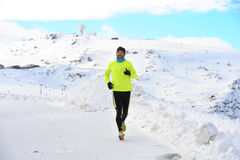 Free Young Healthy Sport Man Running In Snow Mountains In Trail Runner Hard  Workout In Winter Stock Photo - 82140240