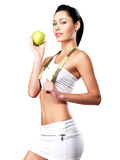 Young healthy woman with apple Royalty Free Stock Photo