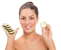 Young healthy woman and cucumbers Stock Images