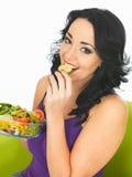 Young Healthy Woman Eating a Fresh Crisp Mixed Garden Salad Stock Image