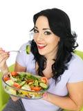 Young Healthy Woman Eating a Fresh Crisp Mixed Garden Salad Royalty Free Stock Photos