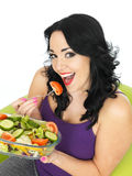 Young Healthy Woman Eating a Fresh Crisp Mixed Garden Salad Stock Image