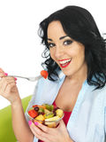 Young Healthy Woman Eating a Fresh Exotic Fruit Salad Royalty Free Stock Photography