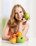 Healthy woman eating fruit, apple at home Stock Images