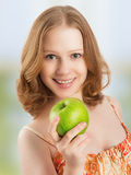 Healthy woman eating fruit, green apple at home Stock Photos