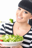 Young Healthy Woman Eating a Healthy Fresh Green Leafed Salad with Tomato Stock Photo
