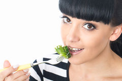 Young Healthy Woman Eating a Healthy Fresh Green Leafed Salad with Tomato Stock Photos
