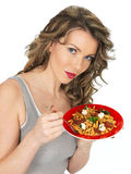 Young Healthy Woman Eating a Pasta Salad Royalty Free Stock Images