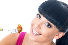 Young Healthy Woman Eating Tomato Pasta with a Fork Royalty Free Stock Photos