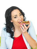 Young Healthy Woman Eating a Wholegrain Cracker with Parma Ham and Sliced Green Olives Stock Image