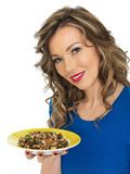 Young Healthy Woman Eating a Wild Rice Mixed Bean Salad Stock Photo