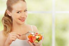 Young Healthy Woman Eats Vegetable Salad Stock Image