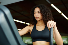 young and healthy woman enjoying time at gym Royalty Free Stock Photo