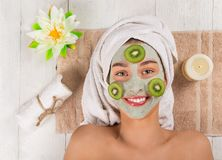 Young healthy woman with face mask. Young healthy woman in spa making treatments and face mask Royalty Free Stock Image