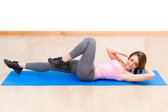 Young healthy woman fitness abdominal exercises Royalty Free Stock Image