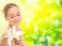 Young healthy woman with flower on floral background Royalty Free Stock Photography