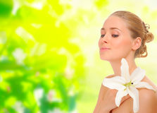 Young healthy woman with flower on floral background Royalty Free Stock Image