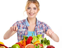 Young healthy woman with fruits and vegetables. Stock Photography