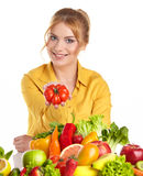 Young healthy woman with fruits and vegetables. Stock Image