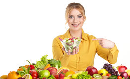 Young healthy woman with fruits and vegetables. Royalty Free Stock Photos