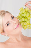 Young healthy woman with a grapes Stock Photo