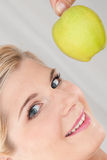 Young healthy woman with green apple Stock Photo