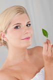 Young healthy woman with green plant Stock Photo